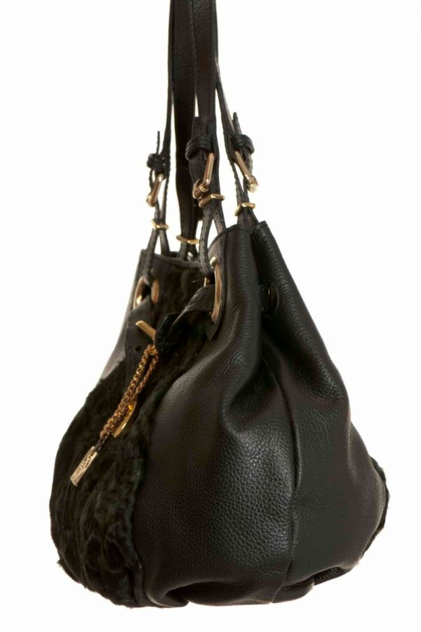 Green fur and leather handbag.